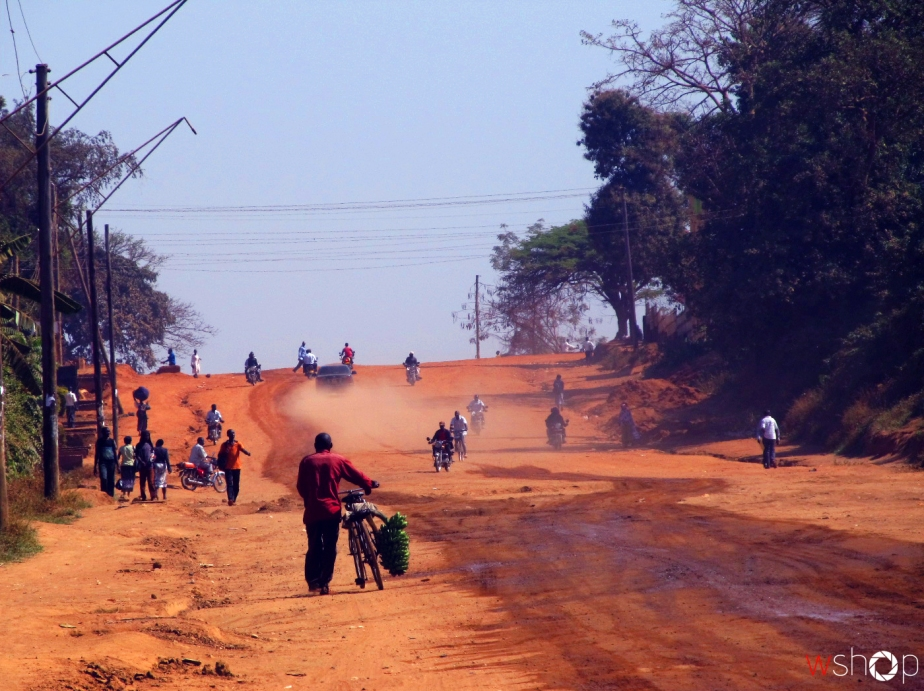 The dusty road being used by heavy trucks connecting to Tororo in Mbale